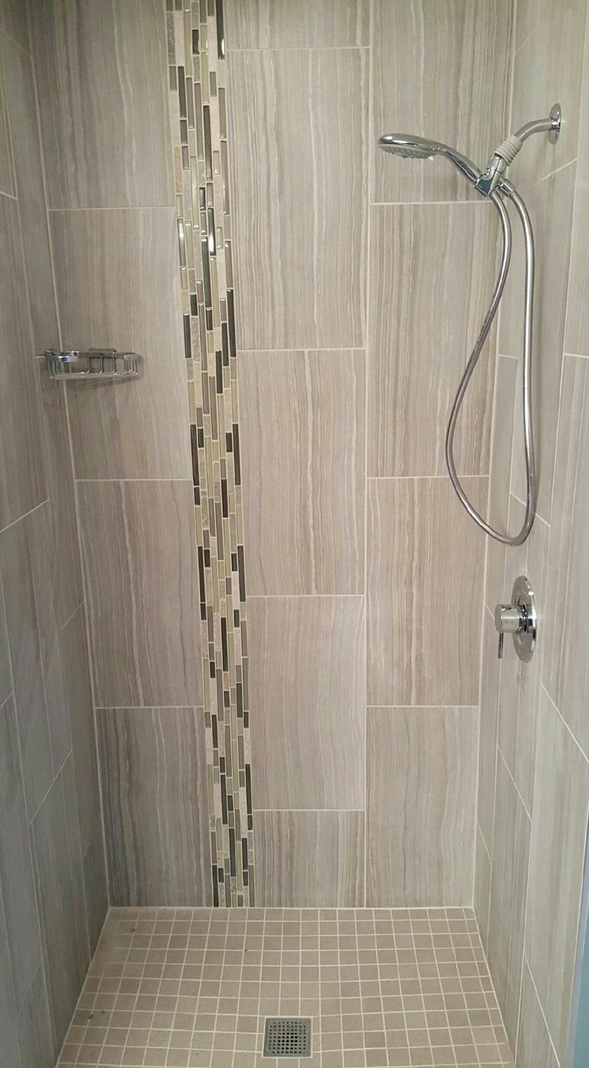 gray vertical rectangular tile with mosaic accent strip